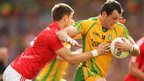 Eoin Cadogan of Cork challenges Donegal forward Michael Murphy during the semi-final clash in Dublin