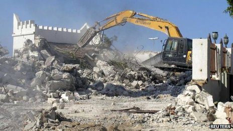 Bulldozers raze a Sufi shrine in Tripoli, 25 August