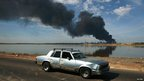 A column of smoke rises, a day after an explosion at Amuay oil refinery in Punto Fijo in the Peninsula of Paraguana 26 August 2012.