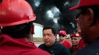 President Hugo Chavez (centre) talks to oil workers while visiting the Amuay refinery site