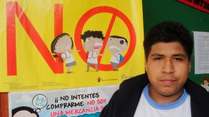 Julinho Ponce in front of an anti-bullying poster