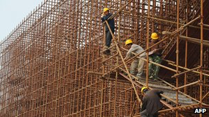 File photo: Labourers at a construction site in China