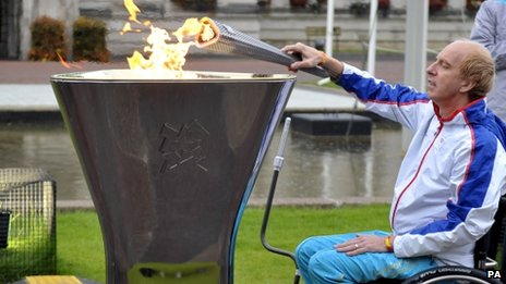Simon Richardson sparks the Paralympic flame outside Cardiff City Hall
