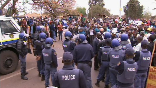 Police officers and protesters gathered near the Marikana mine