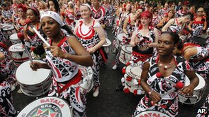 Revellers beating drums at Notting Hill Carnival