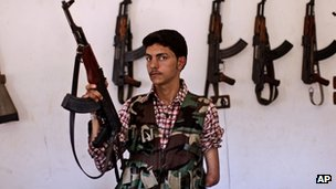 Syrian rebel fighter Ali Alnajjr, 20, a former school student, poses for a picture.