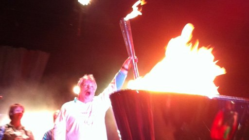 Simon Weston lights the cauldron in Cardiff Bay