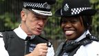 Metropolitan Police Commissioner Bernard Hogan-Howe with a police officer at the carnival