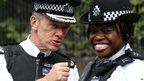 Metropolitan Police Commissioner Bernard Hogan-Howe with a police officer at the carnival