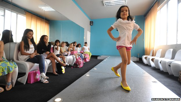 Young girl on the catwalk at Giselle's beauty school
