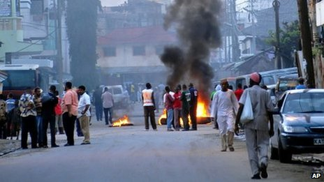 Protesting Muslim youths stand next to burning tyres in Mombasa,  Kenya (27 August 2012)