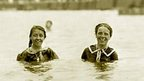 Two girls swimming