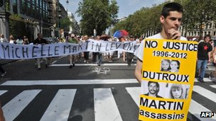 People protest in Brussels against a court decision to grant parole to the ex-wife and accomplice of Belgian paedophile serial killer Marc Dutroux, Michelle Martin, on 19 August 2012