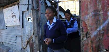 South African teenagers in school uniform in Alexandra township near Johannesburg, June 2012
