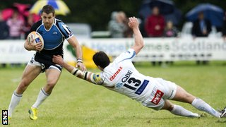 Tommy Seymour is out of reach of Exeter's Ian Whitten in Glasgow's 15-6 pre-season victory