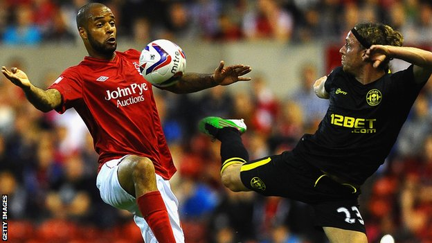 David McGoldrick [l] battles with Wigan's Ronnie Stam