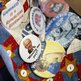 A woman from the North Carolina delegation has buttons on her jacket at the Republican National Convention in Tampa, Florida 28 August 2012
