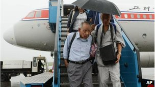 Sadao Masaki, left, arrives at the airport in Pyongyang, 28 August 2012