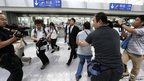 Journalists surround Japanese Foreign Ministry Northeast Asia Division Director Keiichi Ono ahead of talks with North Korea in Beijing
