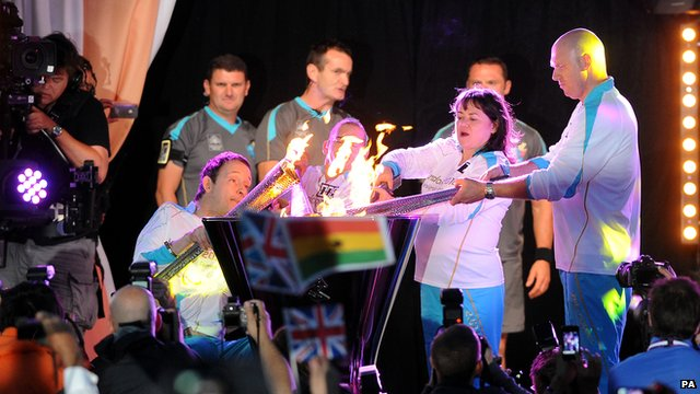 Torchbearers light the cauldron 