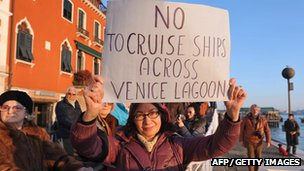 A woman holds a placard reading 'No to cruise ships across Venice lagoon' during a demonstration against the  environmental impact of cruise ships (File)