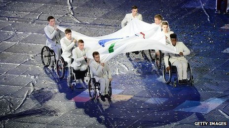 Wheelchair athletes with Paralympic flag