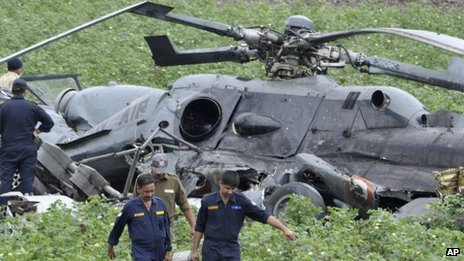 Indian Air Force personnel salvage the remains after two air force helicopters collide and crash in Gujarat on 30 August 2012