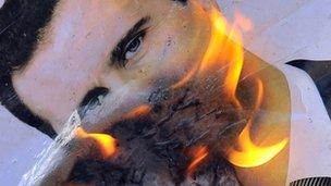 Burning image of President Assad