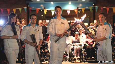 Torchbearers carry the Paralympic torch