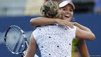 Laura Robson (right) of Britain is congratulated by Kim Clijsters of Belgium after their women&#039;s singles match at the US. Open tennis tournament in New York A