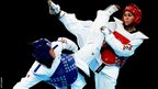 Anne-Caroline Graffe of France competes against Natalya Mamatova of Uzbekistan (red)