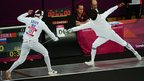 Alexander Lesun of Russia (L) competes against Hwang Woojin of South Korea (R)