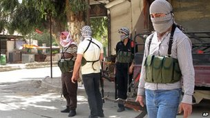 Rebel fighters in a Damascus suburb (file photo)