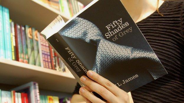 Woman reading Fifty Shades of Grey by EL James