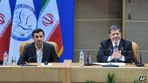 Iranian President Mahmoud Ahmadinejad, left, with Egyptian President Mohammed Morsi in Tehran 30 Aug