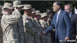 Romney shakes hands with Polish troops