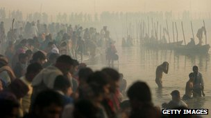 Hindu pilgrims gather to bathe at sunrise at the ritual bathing site at Sangam, the confluence of the Ganges, Yamuna and mythical Saraswati rivers during the Ardh Kumbh Mela festival (Half Pitcher festival) January 23, 2007 in Allahabad, India.