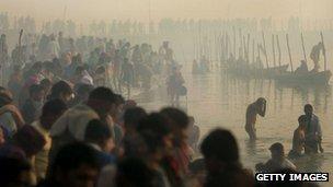 Hindu pilgrims gather to bathe at sunrise during the Ardh Kumbh Mela festival. File photo