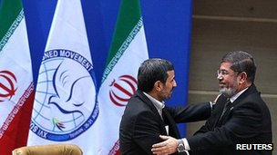 Mahmoud Ahmadinejad (left) and Mohammed Morsi