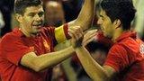 Liverpool captain Steven Gerrard congratulates goal hero Luis Suarez
