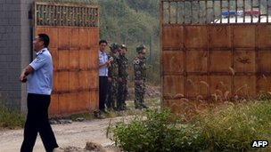 Chinese police outside the Number Two prison after the release of dissident Wang Xiaoning in Beijing on 31 August, 2012