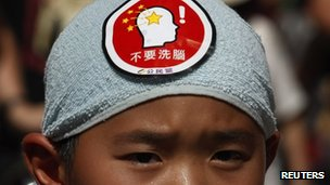 File photo: A child protesting in Hong Kong against Chinese patriotic education in July
