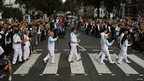A team of torchbearers at Abbey Road crossing