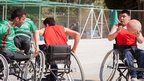 Men playing wheelchair basketball in Kabul