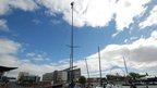 crew member at the top of mast