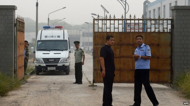 Guards outside No. 2 prison in Beijing where Wang was held