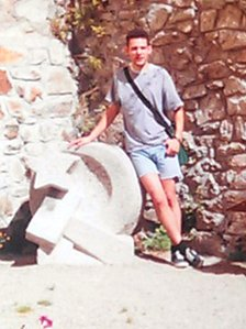 Rob standing next to a Hammer and Sickle in 1992