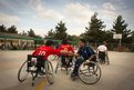 Men shake hands after a wheelchair basketball match in Kabul