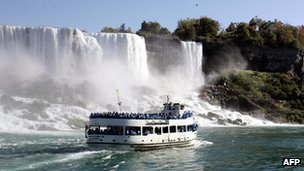 The Maid of the Mist tour boat floats near part of the American portion of Niagara Falls 8 October 2006