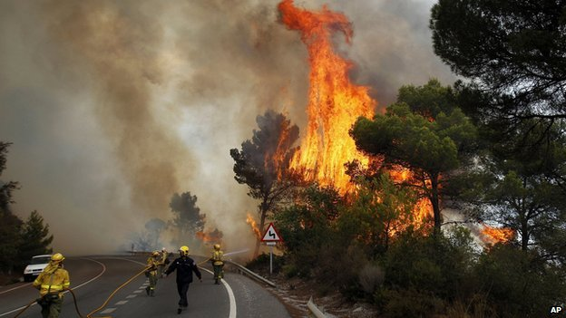 Firefighters try and tackle a blaze near Marbella, Spain.